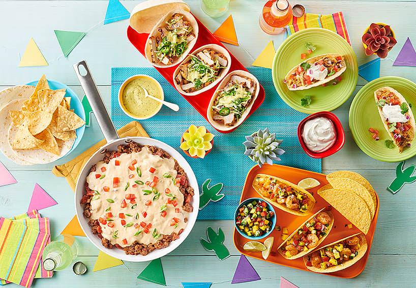 Taco, chips, dip sour cream, taco bowls