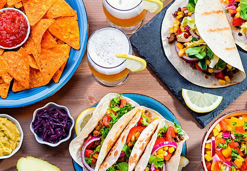 Tacos, chips, salsa, corn, black beans, avocado, beer